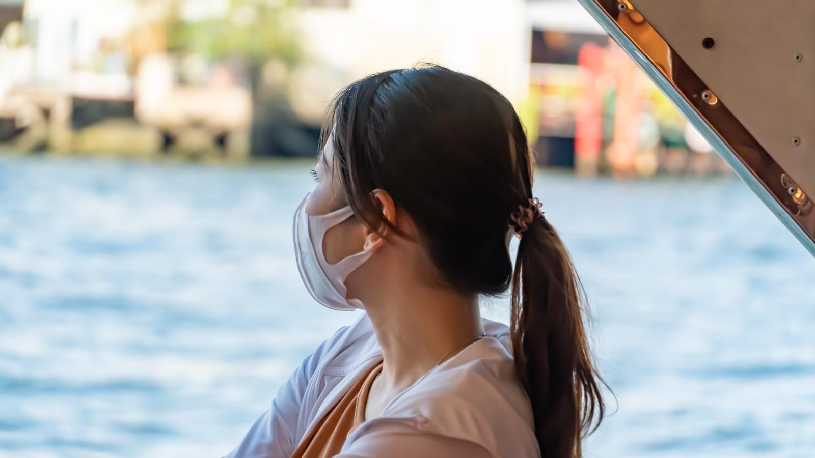 woman in white shirt wearing white sunglasses