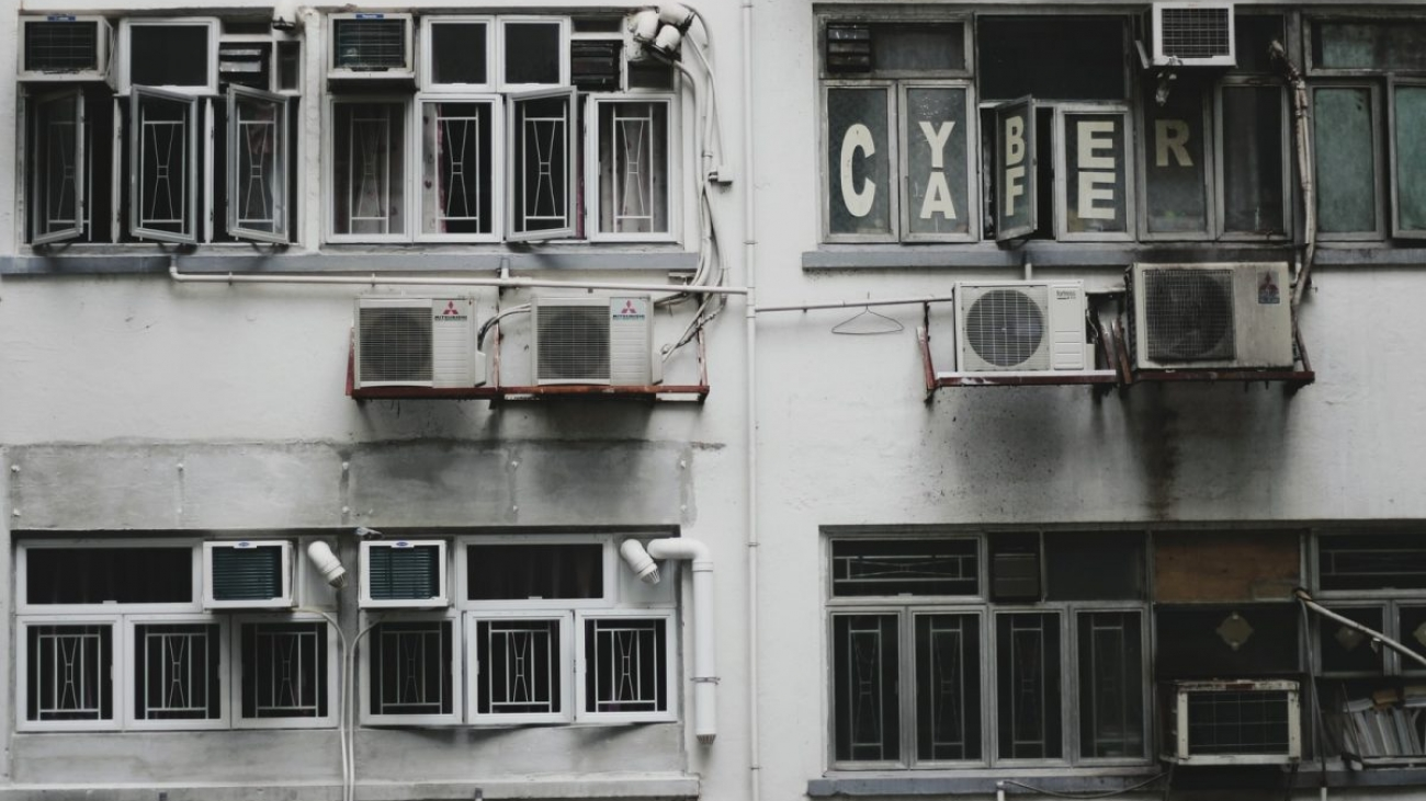 white window-type air conditioner on wall